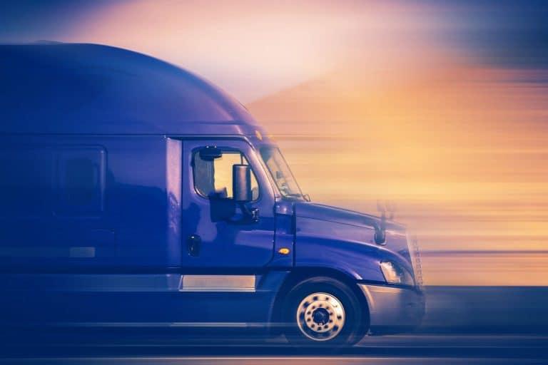 36287528 - rush trucking. speeding blue semi truck on the american highway. trucking concept.